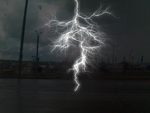 A bolt of lightning hits a highway surface