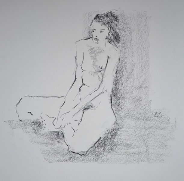 woman sitting hands folded