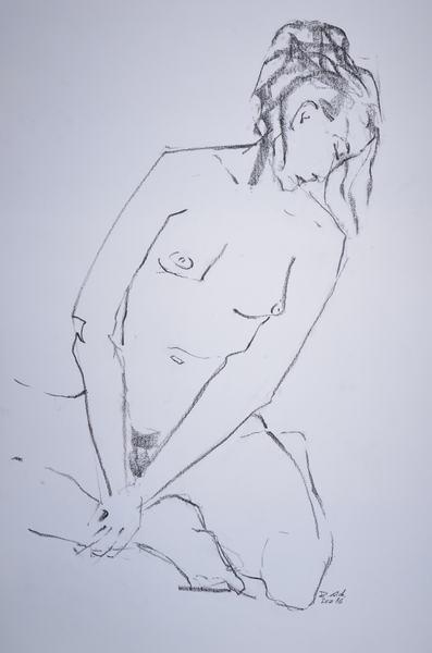 girl with dreadlocks sitting head left bent forward