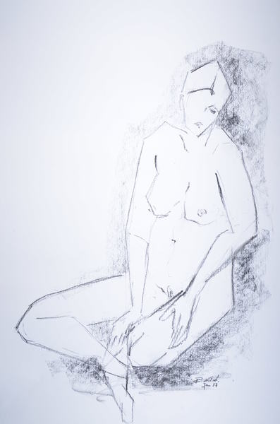 sitting woman with hand on knee
