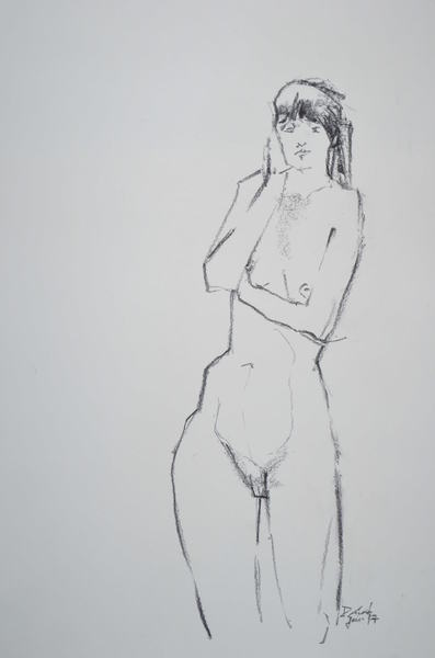 standing woman with hand on cheek