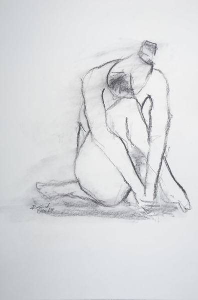 sitting woman with head on knee