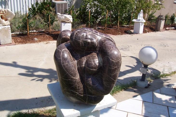 Mother & child embrace by Shimon Drory