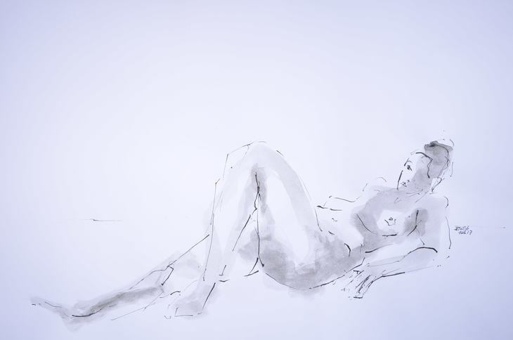 reclining woman one leg tucked up