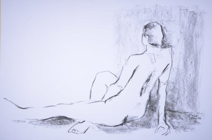 sitting woman resting on right hand