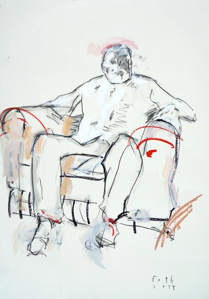 Mann, in einem Sessel sitzend