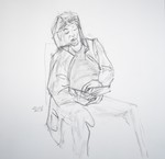sitting man reading a book