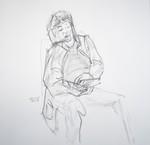 sitting man reading a book