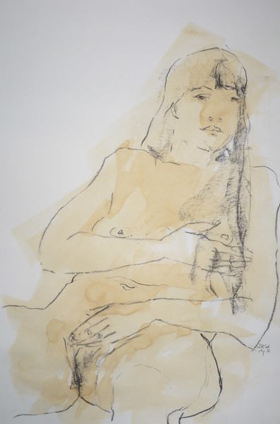 sitting woman holding her breast