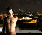 erotic male nude photo man on tel aviv roof assaf  henigsberg