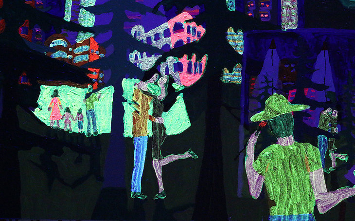 A phosphorescent  glowing painting glows at night in ultraviolet