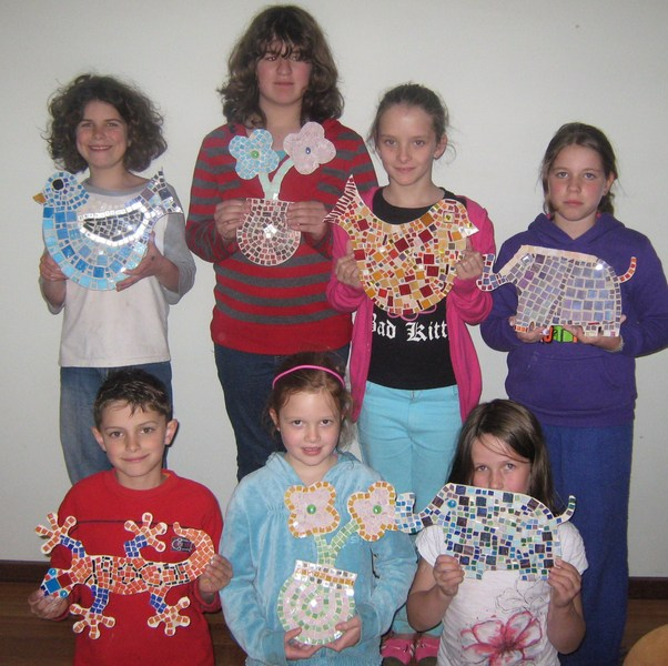 Group of kids final artwork on School Holiday Program