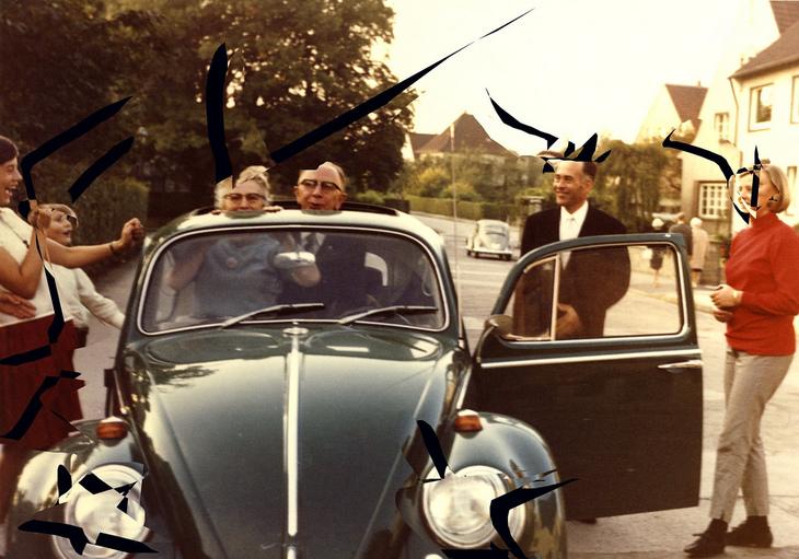 Familie und VW Käfer