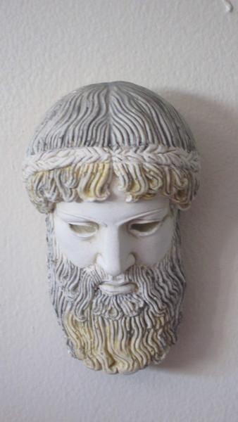 Mythical God in plaster