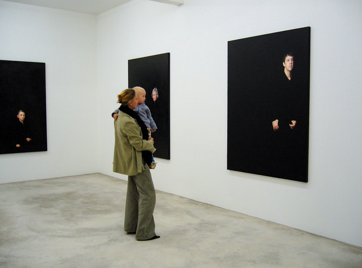 Installation shot of portraits